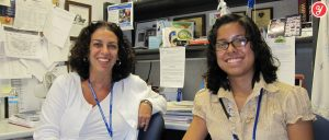 Aida Yoguely interviewing the Boeing Integrated Site Support Manager at the NASA Kennedy Space Center.