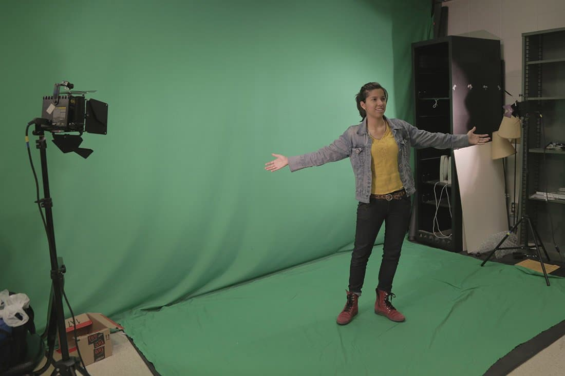 Aida Yoguely filming green screen footage.