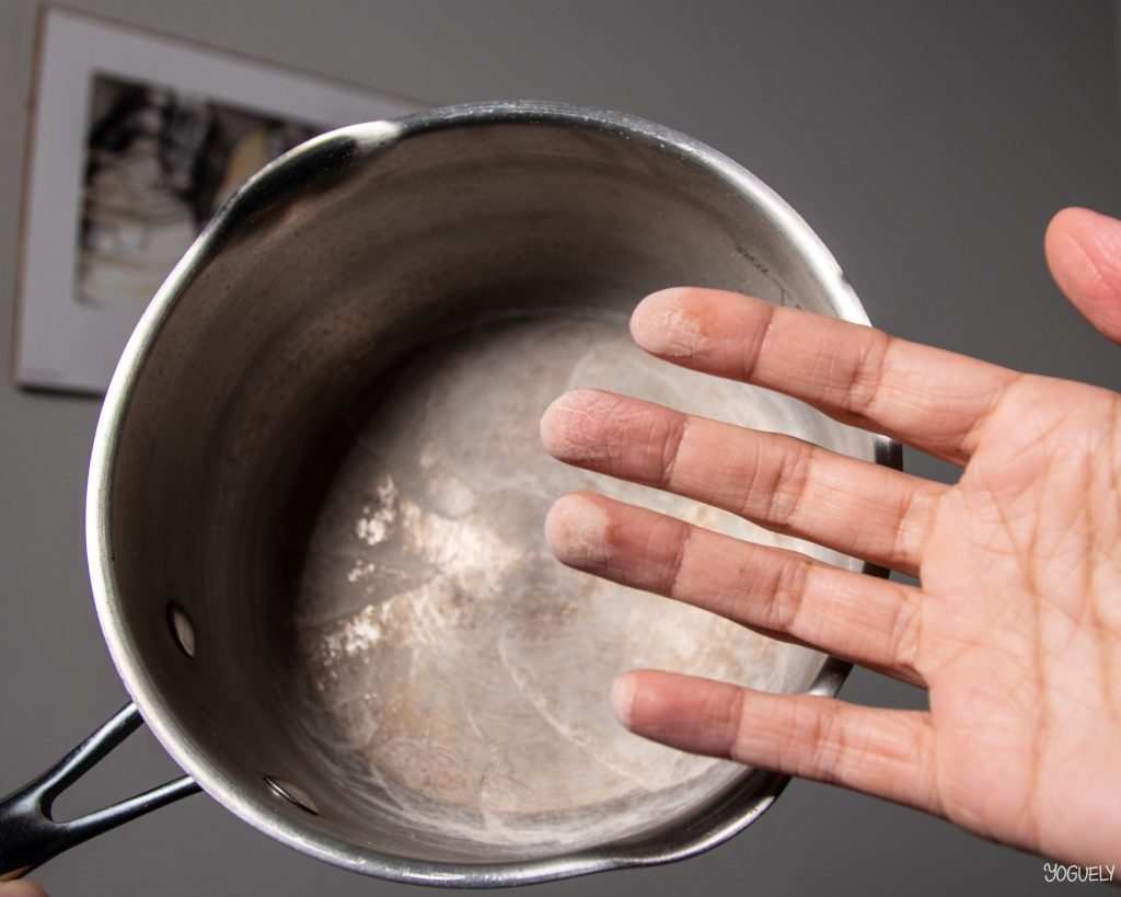 Boiling tap water completely leaves behind dissolved solids, known as limescale and hard water spots. These chaulky white substances are contaminants in the tap water.