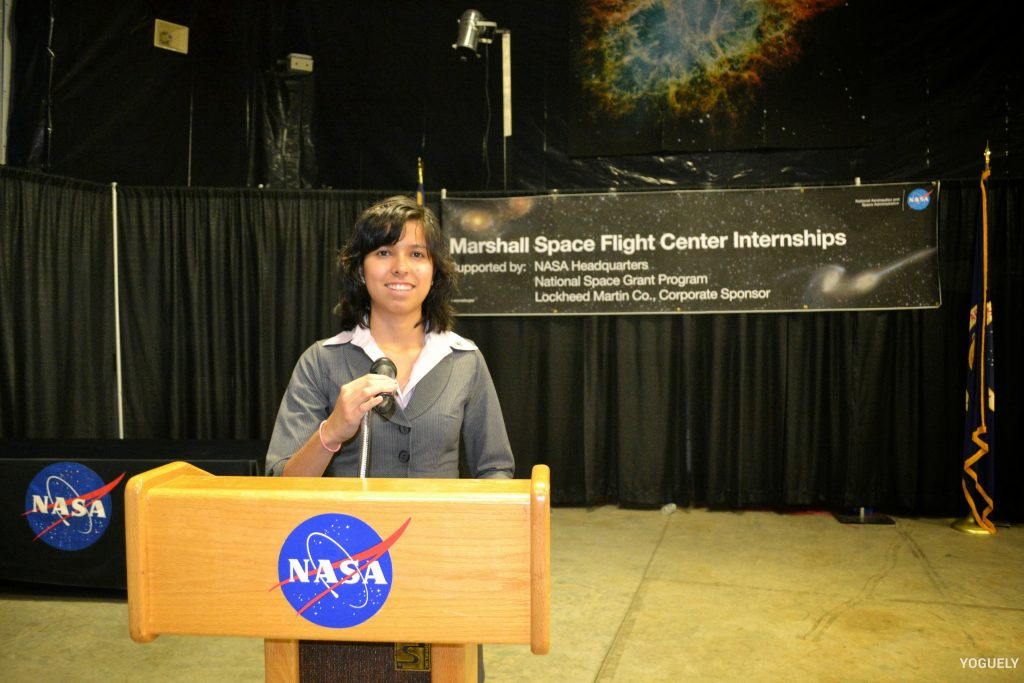 Aida Yoguely working at the NASA Marshall Space Flight Center.